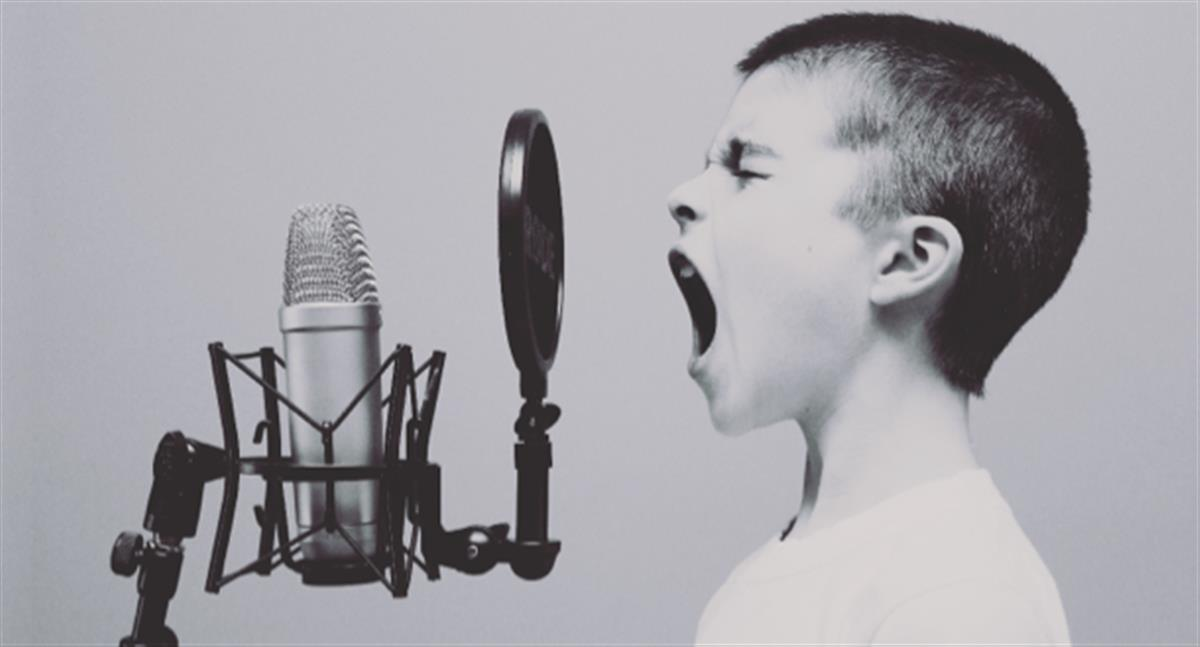Child yelling into mic
